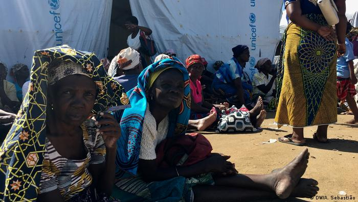 Women sit outside a UNICEF tent in Mozambique.