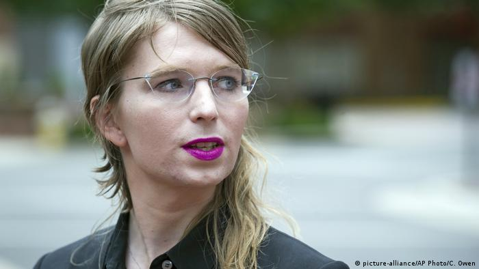 Chelsea Manning wearing stylish eyeglasses and purple lipstick.