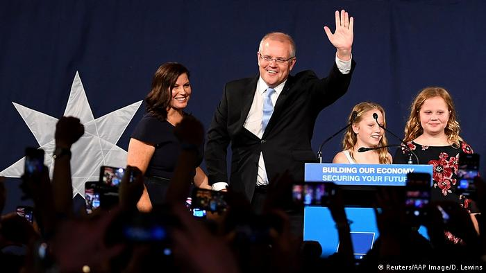 Scott Morrison waves to a crowd celebrating the conservatives' victory