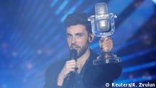 Participant Duncan Laurence of the Netherlands holds up the trophy after winning the 2019 Eurovision Song Contest in Tel Aviv, Israel May 19, 2019. REUTERS/Ronen Zvulun