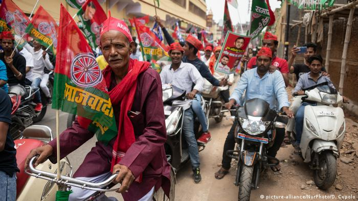 A group of people on motorbikes take part in a rally in the city of Varanasi