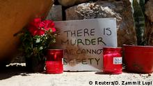 Candle and messages at the spot where the migrant was murdered (Reuters/D. Zammit Lupi)