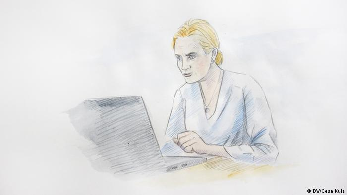 Woman with concerned facial expression looking at her laptop