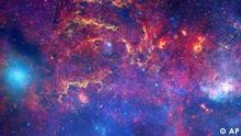 This image provided by NASA Tuesday Nov. 11, 2009 shows observations from the Hubble Space Telescope, the Spitzer Space Telescope, and the Chandra X-ray Observatory in a collaboration to produce an unprecedented image of the central region of our Milky Way galaxy using infrared light and X-ray light to see through the obscuring dust and reveal the intense activity near the galactic core. Note that the center of the galaxy is located within the bright white region to the right of and just below the middle of the image. The entire image width covers about one-half a degree, about the same angular width as the full moon. Each telescope's contribution is presented in a different color. Yellow represents the near-infrared observations of Hubble. The observations outline the energetic regions where stars are being born as well as reveal hundreds of thousands of stars. Red represents the infrared observations of Spitzer.