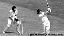 England's Dennis Amiss moves out of his crease to hit India's Abid Ali for four runs at Lord's Cricket Ground in London on Saturday, June 7, 1975, en route to his innings of 137 for England in the World Cup championship cricket trophy. England won the game by 202 runs. Behind the wicket is Farouk Engineer. (AP Photo/Peter Kemp) |
