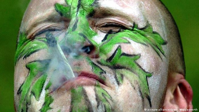 Weed smoker with a face painting