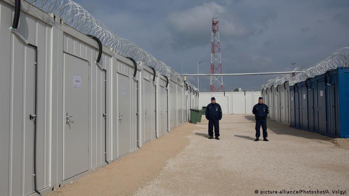 Hungarian policemen are seen at the transit zone housing asylum seekers