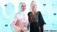 Arabic author Jokha Alharthi (L) and translator Marilyn Booth pose after winning the Man Booker International Prize for the book 'Celestial Bodies' in London on May 21, 2019. (Photo by Isabel INFANTES / AFP)