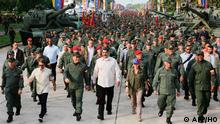 Handout photo released by the Miraflores Palace press office showing Venezuela's President Nicolas Maduro (C), his wife Cilia Flores (3-R) and Venezuelan Defense Minister Vladimir Padrino (3-L) walking during the march of loyalty with personnel of the Venezuelan Bolivarian National Armed Forces (FANB) in Carabobo state, Venezuela on May 21, 2019. (Photo by HO / Venezuelan Presidency / AFP) / RESTRICTED TO EDITORIAL USE - MANDATORY CREDIT AFP PHOTO / VENEZUELAN PRESIDENCY - NO MARKETING NO ADVERTISING CAMPAIGNS - DISTRIBUTED AS A SERVICE TO CLIENTS