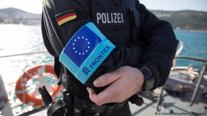 A man in a uniform with the Frontex logo and German flag