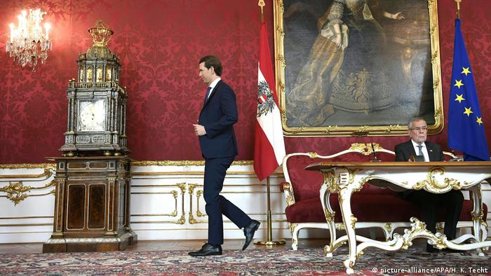 Austrian Chancellor Sebastian Kurz walks away from the president at the swearing-in ceremony of his new government