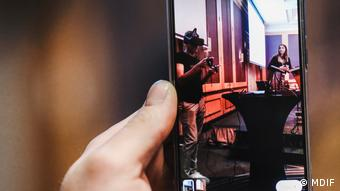 A smartphone screen shows the presentation of VR gear