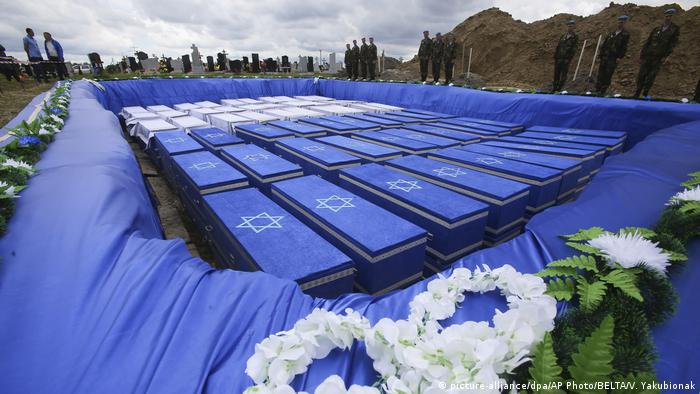 Coffins are seen before burying the remains of Holocaust victims at a cemetery just outside Brest, Belarus