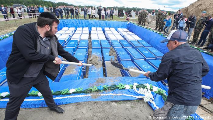 Members of Jewish communities rebury the remains of Jews killed by the Nazis, at the Severnoye [Northern] cemetery; the remains of hundreds of prisoners of a former Jewish ghetto were discovered on a construction site.