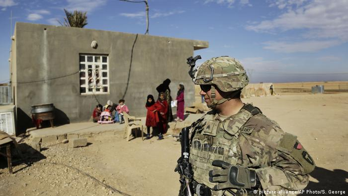 U.S. Army soldiers speak to families in rural Anbar on a reconnaissance patrol
