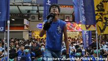 In this Saturday, July 11, 2015 photo, Ray Wong Toi-yeung, center, member of Hong Kong Indigenous group shouts slogan during a demonstration in Hong Kong. Germany has granted asylum to two Hong Kong activists in a sign of growing concern over how dissent is dealt with in the territory. (AP Photo/Kin Cheung) |