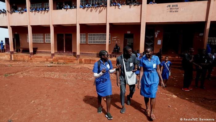 Gaelle and her classmates leave the school building (Reuters/Z. Bensemra)