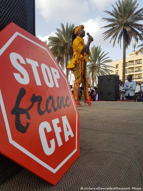 Activist Etuma Seba speaking at an anti-CFA protest in Dakar, Senegal