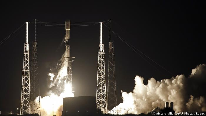 A Falcon 9 SpaceX rocket launch at night