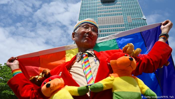 Taiwan gay activist Chi Chia-wei poses for photos in front of Taipei 101 tower