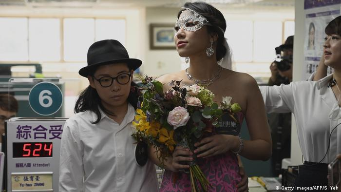 Gay couple Cynical Chick and Li Ying-Chien wait for wedding register