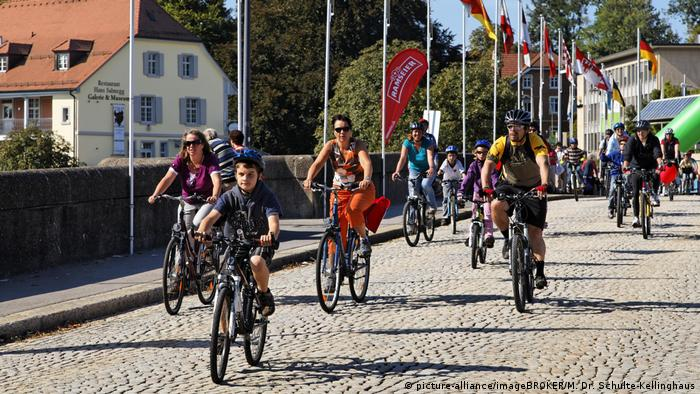 Cyclists crossing a bridge across the river Rhine in Basel during the Slow Up festival.(picture-alliance/imageBROKER/M. Dr. Schulte-Kellinghaus)