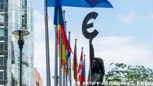 Euro sign in fron of the building of the European Parliament