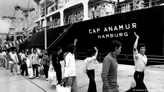 One of the photos in the exhibition at the International Maritime Museum: Vietnamese refugees depart the Cap Anamur in Hamburg; between 1979 and 1986, more than 11,000 refugees were rescued at sea via the revamped ship and brought to safe harbor (ullstein bild - Poly-Press)