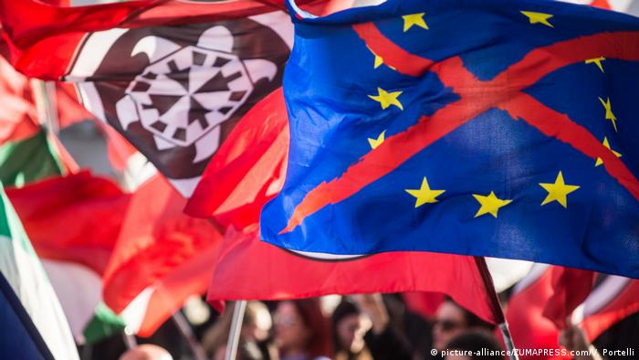 Protesters wave CasaPound flags along with an EU flag with an X through it