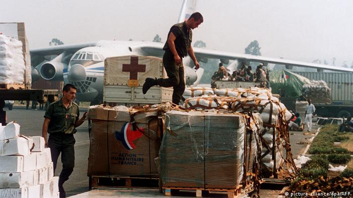 Two French soldiers examine aid boxes for refugees at the airstrip in Goma (1994)