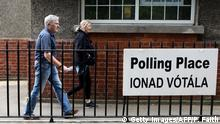 Voters leave after casting their vote in the European Elections, and in Ireland's Local Elections and the Divorce Referendum, being held concurrently, at a polling station at Drumcondra National school (PAUL FAITH/AFP/Getty Images)