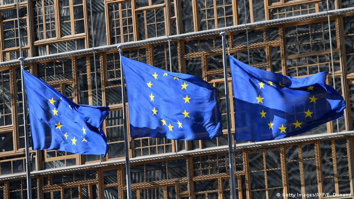 EU flags outside the European Council in Brussels