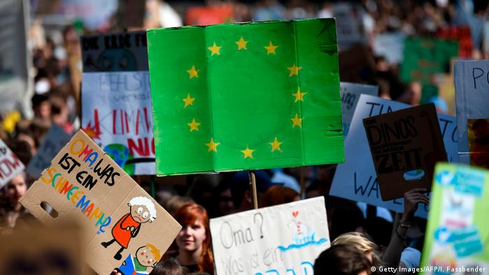 Fridays for Future protest, featuring a green European Union placard