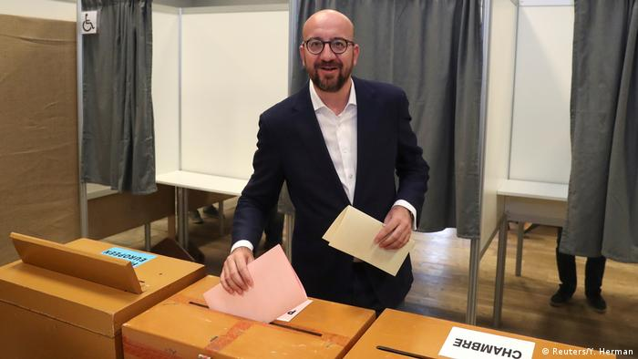 Belgian Prime Minister Charles Michel prepares to cast his vote for the Belgian general and regional elections and for the European Parliament Elections in Limal