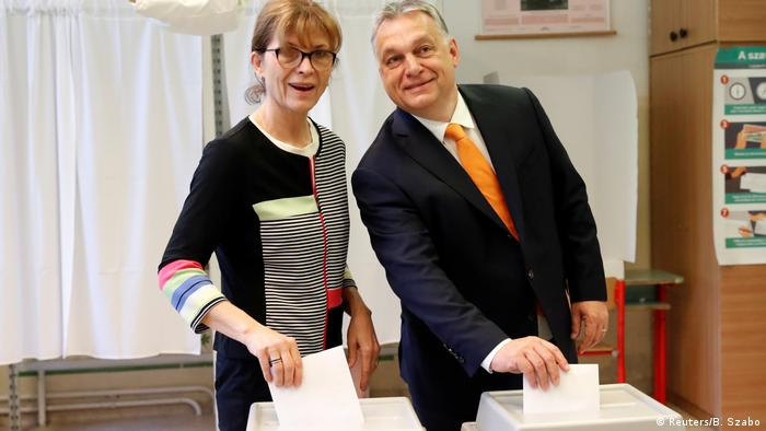Hungarian Prime Minister Viktor Orban and his wife Aniko Levai cast their ballots during the European Parliament Elections in Budapest (Reuters/B. Szabo)