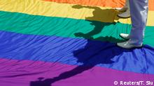 May 25, 2019*** Gay newlyweds walk on a giant rainbow flag at a pro same-sex marriage party after registering their marriage in Taipei, Taiwan May 24, 2019. REUTERS/Tyrone Siu
