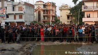 A crowd gathers at the site of an explosion in Kathmandu