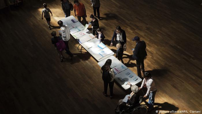 Voters pick up voting material in Lyon