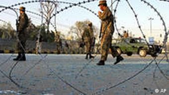 Soldiers behind barbed wire in Pakistan