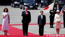 27.05.2019 U.S. President Donald Trump and first lady Melania Trump stand at attention next to Japan's Emperor Naruhito and Empress Masako at the Imperial Palace in Tokyo, Japan May 27, 2019. REUTERS/Jonathan Ernst