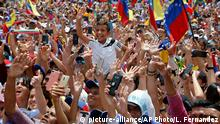 26.05.2019 Supporters of Venezuela's opposition leader and self-proclaimed interim president, Juan Guaido, cheer for him during a rally where he spoke in Barquisimeto, Venezuela, Sunday, May 26, 2019. The Venezuelan government and opposition have returned to Norway for a mediation effort aimed at resolving the political crisis, after months of escalating tension between Venezuelan President Nicolás Maduro and Guaidó, the U.S.-backed opposition leader. (AP Photo/Leonardo Fernandez)