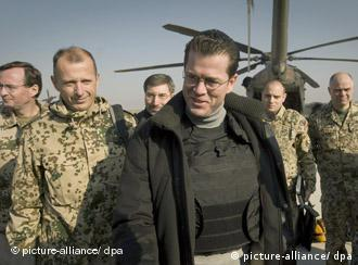 Defense Minister Karl-Theodor zu Guttenberg greeting German troops in Afghanistan