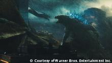 A film still from GODZILLA II KING OF THE MONSTERS shows godzilla battling a snake-like creature (Courtesy of Warner Bros. Entertainment Inc.)