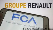 May 26, 2019 - Asuncion, Paraguay - Logo of Fiat Chrysler Automobiles, an Italian-American multinational auto maker, is seen on a smartphone screen against the logo of Groupe Renault, a French multinational automobile manufacturer, unfocused on background. (Credit Image: © Andre M. Chang/ZUMA Wire |