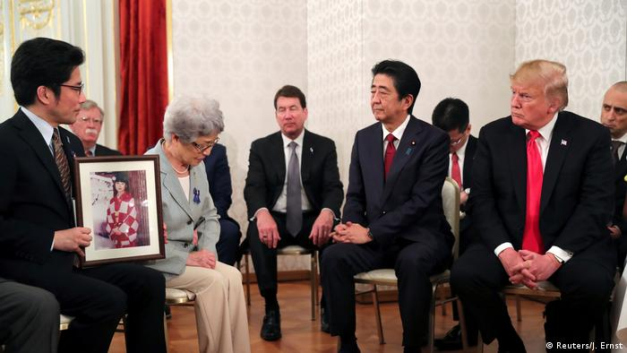 US President Donald Trump and Japan's Prime Minister Shinzo Abe meet with family members of people abducted by North Korea, at Akasaka Palace in Tokyo REFILE - UPDATING SLUG AND ADDITIONAL INFORMATION U.S. President Donald Trump and Japan's Prime Minister Shinzo A