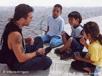 Vittorio Arrigoni with three children