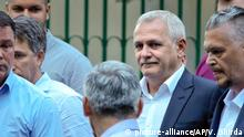 FILE- In this Sunday, May 26, 2019, file photo Liviu Dragnea, the head of the ruling Social Democratic party leaves a voting station after casting his vote in the European Parliament elections, in Bucharest, Romania. The High Court for Cassation and Justice has sentenced Dragnea to serve 3 and a half years in prison for intervening from 2006-2012 to keep two women on the payroll of a family welfare agency, even though they were working for his party instead. (AP Photo/Vadim Ghirda, File)