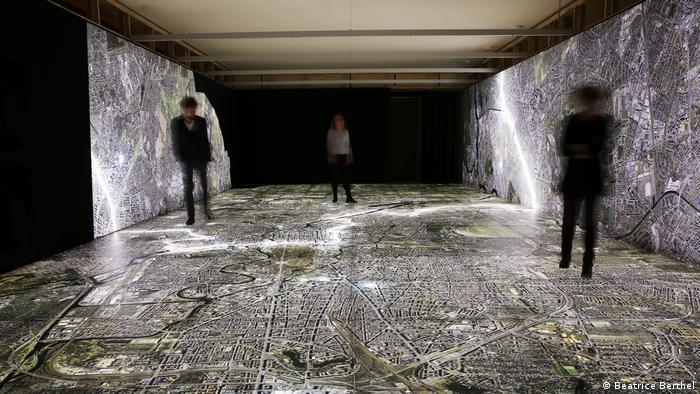 People cross a map of Berlin by foot