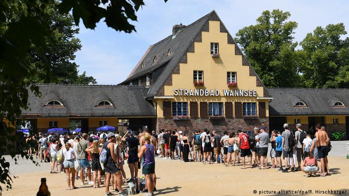 Berlin Strandbad Wannsee pool building with people waiting in lines to get in