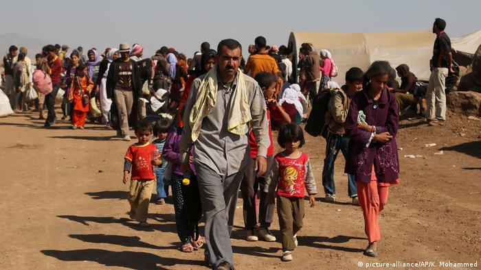 Yazidi refugees arrive at a camp in Syria after fleeing 'Islamic State' fighters